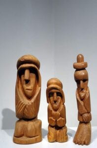 3 wood carved figures