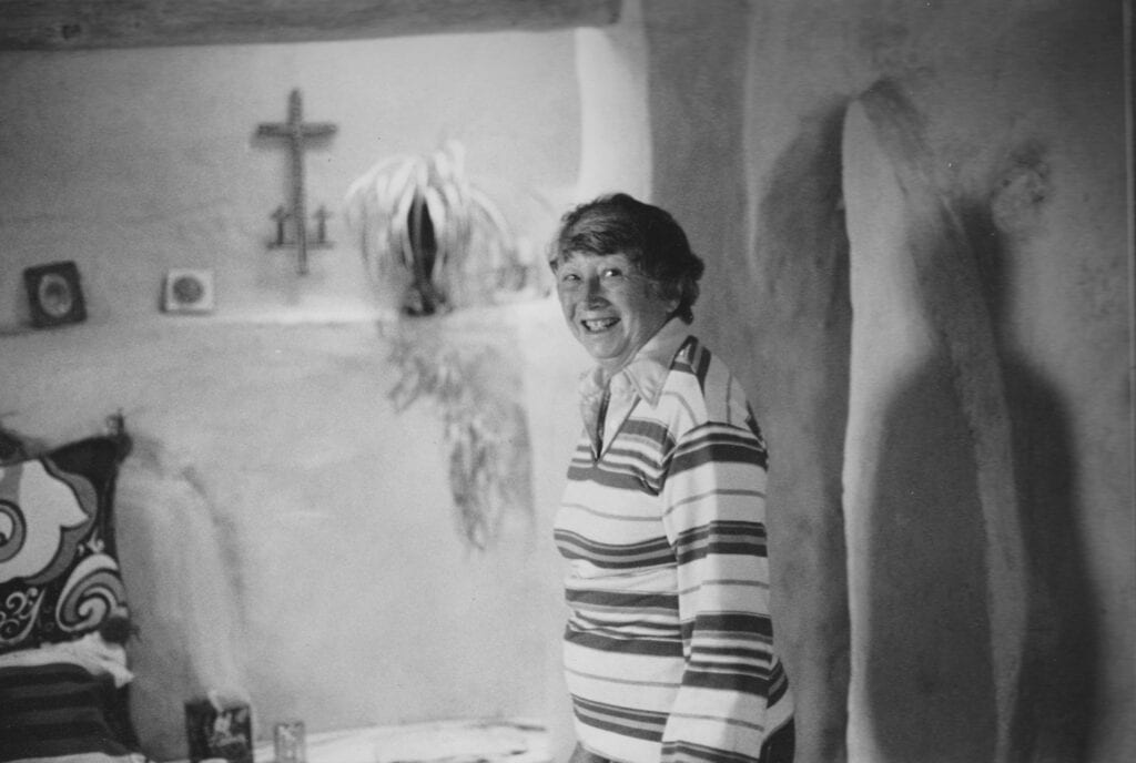 Photograph of Adeine de La Noe in adobe home